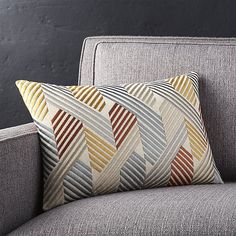 Slim, multicolored embroidered stripes criss and cross in this graphic and dimensional pillow. Pillow reverses to solid cotton. Our decorative pillows include your choice of a plush feather-down or lofty down-alternative insert at no extra cost.