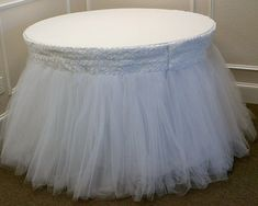 A unique wedding cake table skirt created by Floral Designs by Meta