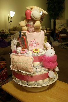 Lots of diaper cake ideas  http://thecookduke.com/make-a-diaper-cake/  http://thecookduke.com/make-a-diaper-cake-2/