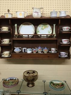 Maple wall shelving unit holds some treasures and things.