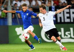Italy's forward Domenico Berardi (L) and Germany's defender Yannick Gerhardt vie for the ball during the UEFA U-21 European Championship Group C football match Italy v Germany in Krakow, Poland on June 24, 2017. / AFP PHOTO / JANEK SKARZYNSKI