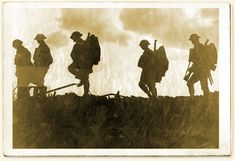 Five soldiers silhouetted while on the march during the First World War Battle of Broodseinde.  Collection Imperial War Museum