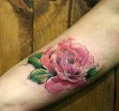 Znalezione obrazy dla zapytania tatuaż róża na plecach