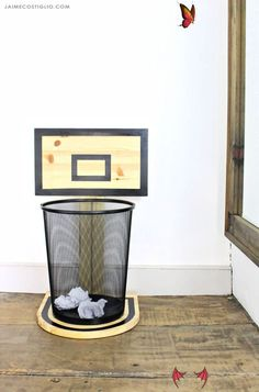 DIY Basketball Hoop Trash Can - Jaime Costiglio  <br> A DIY tutorial to build a wood basketball hoop trash can holder. Make clean up fun and add sports themed decor with free plans for a basketball backboard. Wood Projects For Beginners, Scrap Wood Projects, Wood Working For Beginners, Diy Projects, Reclaimed Wood Furniture, Woodworking Furniture, Woodworking Projects, Woodworking Plans, Pallet Furniture