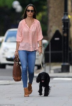 Pippa Middleton walked her dog on Monday evening, again with her asscher radiant diamond ring, which is estimated to have cost £200,000, on display