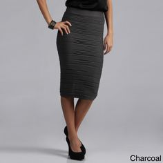 You'll want to order one of these stretch high-waist pencil skirts in each of the five colors that are available. These skirts are comfortable thanks to their elastic waistband, and their pleated texture gives them that special fashionable touch.