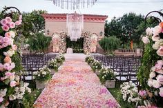 Lush Pink %26 Apricot Flower Aisle    Photography: Handeland Tesoro Photography   Read More:  http://www.insideweddings.com/weddings/alfresco-jewish-wedding-ceremony-lush-reception-in-san-diego/784/
