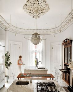 Old architecture, with artichoke light and Philippe Starck's ghost chairs, marble countertops.  Sigh.