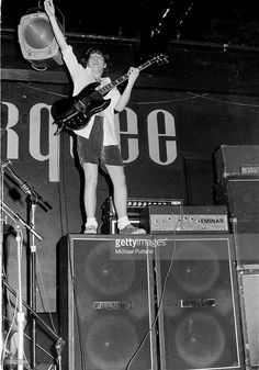 AC/DC perform on stage at the Marquee, London, July 1976, Angus Young.