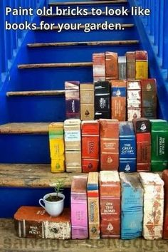 Paint bricks to look like old books for your garden. Pair with tea cups with small plants. Love this!!