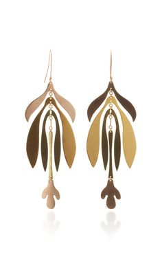 Shop Inflorescence Earrings. Sculpted with organic lines, these earrings are carefully balanced and full of movement.