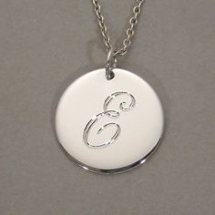 Sterling silver personalized E letter pendant monogrammed necklace on a 5/8 inch round circle disc charm SDLCS-L. $49.00, via Etsy.