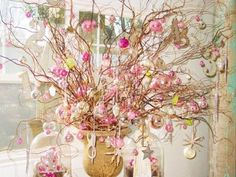 pink ornaments on bare branches