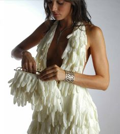 This site has loads of GREAT examples of what you can do with recycled materials and clothing