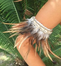 "Short crocheted choker with Cowrie shells, silver beads and feathers. Hand-made in Bali. Can be worn as choker, arm jewelry and anklet. Necklace length approximately 7.5"" yet may vary slightly due to"