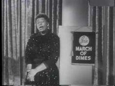 Ella Fitzgerald, The First Lady of Song, is seen here performing. In 1958, on a television public service announcement, Ella Fitzgerald asked viewers to support the 1958 March of Dimes, and its fight against polio.