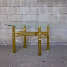 """Vintage 70s Brass & Glass Accent Table in the style of Pace Tubular Cylindrical Legs Brass/Gold Plated Swirl Accent on base Unique geometrical glass shape In """"As Found"""" Condition. Wear is good for its age. Some minimal scratches or nicks to the finish. Dimensions: 47""""L x 17""""W x 26""""H Pictures Additional pics available at VintagePopandVice.Com or upon request. Local Pick Up Pomona CA (91768) Delivery Available throughout Southern California. Contact us with your zip code or city for a quote…"""