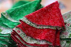 Very cute DIY circular cloth Christmas napkins folded into Christmas trees.