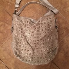 """Embellished with Bling Silver Hobo bag Silver hobo handbag adorned with studs/clear gemstones, removable double straps, has side zipper enclosure, interior is clean but has signs of use; such as, ink pen marks. Always had a lot of comments and compliments when I used this bag. Measurements are: 15"""" x 15"""" Blue Elegance Bags Hobos"""