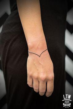 Wrist minimalistic bracelet tattoo