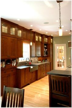 craftsman kitchen-- pale green may just be the kitchen color again / style of cabinet doors