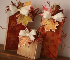 2 X covered with Designer Series Paper, leaves & raffia added for great fall pumpkins! Looks like cut branches for the top. Autumn Crafts, Thanksgiving Crafts, Thanksgiving Decorations, Holiday Crafts, Fall Decorations, 2x4 Crafts, Wood Block Crafts, Fall Halloween, Halloween Crafts