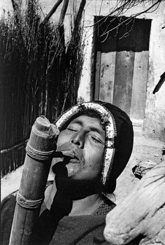 1958 by Sergio Larrain | Bolivia, Tarabuco. Indian playing the Tocoro, typical instrument of the region