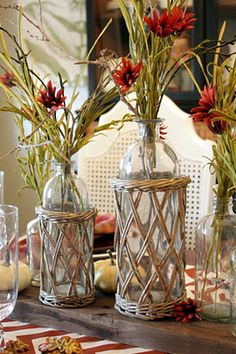 Great use of glass & wicket for the flower arrangements