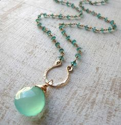 Seafoam green briolette drop, wire wrapped on hammered horseshoe focal point. Simple, unique, and great alternative to a traditional bail. Wire Jewelry, Jewelry Crafts, Beaded Jewelry, Jewelry Box, Jewelery, Jewelry Accessories, Handmade Jewelry, Jewelry Necklaces, Beaded Necklace