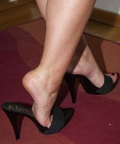 Black mules and popped heel
