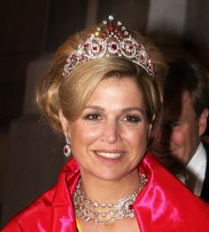 Queen Máxima of the Netherlands, wearing the Ruby Peacock Parure: tiara, necklace and earrings.