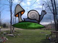 snail and mushroom stained glass suncatcher