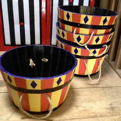 Hand painted barrels in a circus style. With rope handles these have been designed with the idea of carrying or holding contained drinks. Other uses include a container for a hessian sack of peanuts or other nuts - you can't get much more circus styled than that! Dancing shoes holder, or whatever else needs holding or containing! Turned upside down these can also be used as a lightweight plinth. They have been waterproofed but are still not recommended for inside use as they can occasionally…