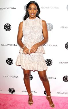 KELLY ROWLAND in a tiered, lacy minidress, plus ankle-strap sandals and delicate jewels