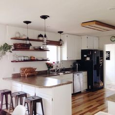 White kitchen, open shelving, cage industrial lights