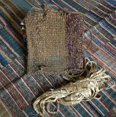 This is a beautifully rustic, hand twined bag–a kind of combination of a back pack/back pad.  It is braided from bast fiber rope which is covered in cotton. Twined Bag from Sri Textiles