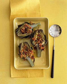 Grainy mustard mixed with bacon and diced vegetables tops steamed artichokes. The mustard and bacon dressing is best when made and served immediately. The artichokes, however, can be prepared in advance.