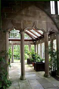 Gothic arches, paned window, stone floors, and green plants create the Medieval-style inside the Regency-period greenhouse on the grounds of Culzean Castle. Photo by Lynn Suckow