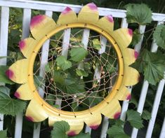 Outdoor dreamcatcher made out of a tire.