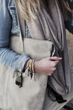 Denim and greys.. Love those neutral tassel bracelets and that perfect grey tote.