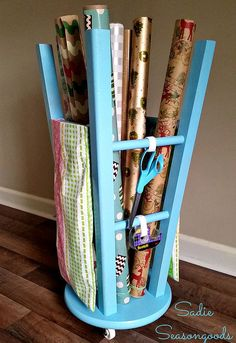 upcycled kitchen stool gift wrap caddy, crafts, organizing, repurposing upcycling, storage ideas. Put casters on bottom, Can have storage bags hang of side.