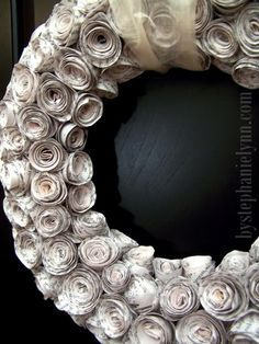 Curled Recycled Book Pages Rose Wreath. Go to your local used bookstore and find a book or two that obviously no one will really want to read again. Make sure they have matching paper, or that you intentionally mix paper types in your project. This project may take a weekend to finish, though.