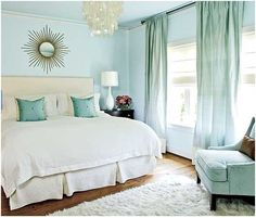 southern living aqua and gold bedroom with chandy