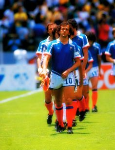 Michel Platini of France leads the team out before the World Cup quarter-final against Brazil at the Jalisco Stadium in Guadalajara, Mexico. France won the match 4-3 on penalties.