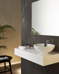 Cuarto de baño con lavabo sobrepuesto