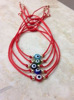 "Evil eye Bracelet Red String. Turkish Eye Red Bracelet. Fashion jewelry. The evil eye is a ""luck charm"" amulet. is believed that reflects and protects the person who wears it from any misfortune. 