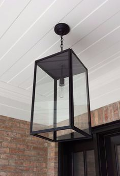 An outdoor lantern with an industrial, modern design, the Vista lantern is an updated option for the traditional lantern. This lantern is available in 3 sizes. Hanging Porch Lights, Porch Lighting, Hanging Lanterns, Outdoor Lighting, Outdoor Lantern, Lighting Ideas, House Lighting, Exterior Lighting, Porch Lanterns