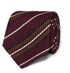 Each Drake's tie goes through 18 quality control checks to ensure it meets the impeccable standards of the brand. Entirely handmade in London, this silk accessory is a fine example of the company's commitment to craftsmanship. This classic piece is woven with a rich texture and sports burgundy, white, navy and mustard stripes.