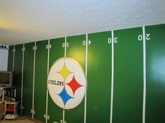 Wallpaper stripes, stencils and some paint. VOILA!  Noah's room. Yes , I painted the steelers on his wall, no, I wasn't happy about it.. and yes we'll let him continue to live here but only until he's 18 or learns to like the Colts!!