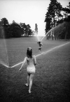 running through the sprinklers.